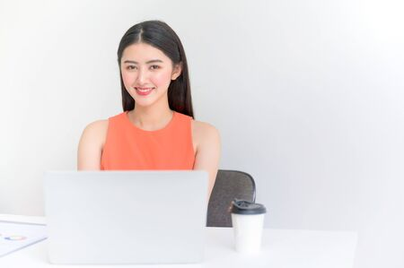 Young asian businesswoman working on laptop in office with document Stock Photo