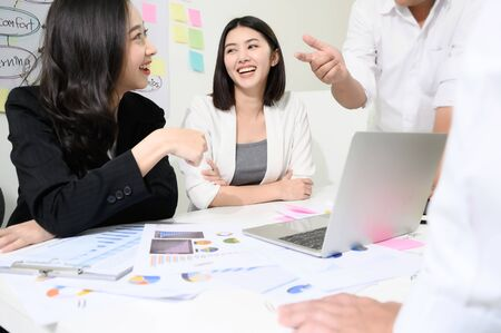 Group young asian businesswoman and businessman people have fun and talking or discuss about work in workplace Stock fotó