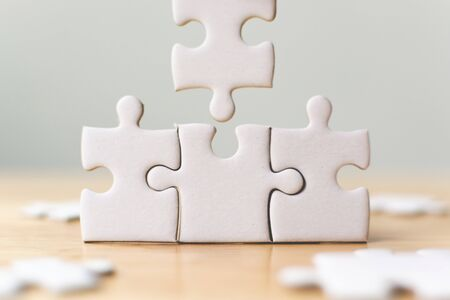 White jigsaw puzzle connecting together. Team business success partnership or teamwork concept Banque d'images