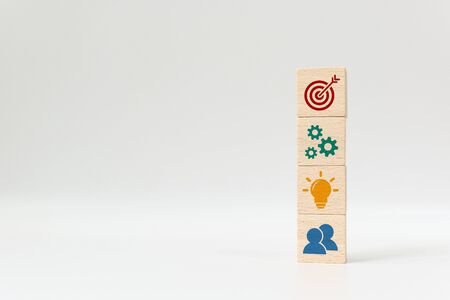 Concept of business strategy and action plan. Wood cube block stacking with icon on white background
