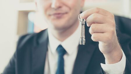 Real estate agent giving house keys to client. Property investment and financial mortgage Standard-Bild
