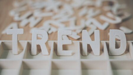 Wooden typography word TREND on wood table concept