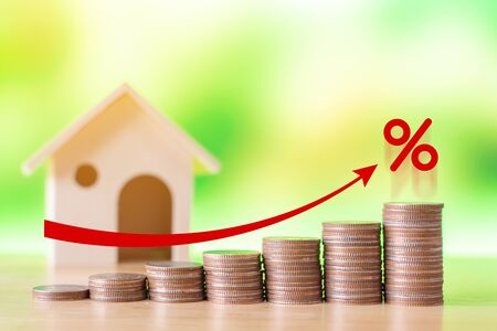 Coin stack step up graph with red arrow and percent icon, Risk management business financial and managing investment percentage interest rates concept Stock Photo