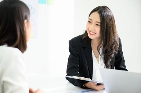 Job interview, We are hiring, Human resource and recruitment concept. Beautiful young asian businesswoman talking applicant people