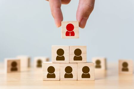 Human resource management and recruitment business concept, Hand putting wood cube block on top pyramid, Copy space