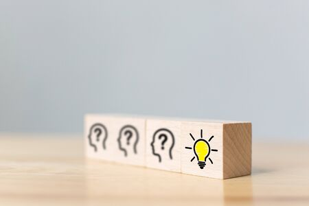 Concept creative idea and innovation. Wooden cube block with head human symbol and light bulb icon 写真素材