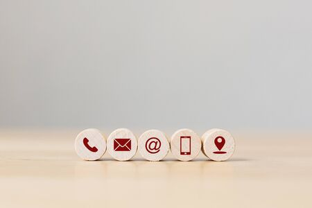 Wooden sphere with symbol telephone, email, address mobile and location. Conceptual of contact us and e-mail marketing concept