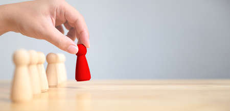 Human resource, Talent management, Recruitment employee, Successful business team leader concept. Hand chooses a wooden people standing out from the crowd Zdjęcie Seryjne