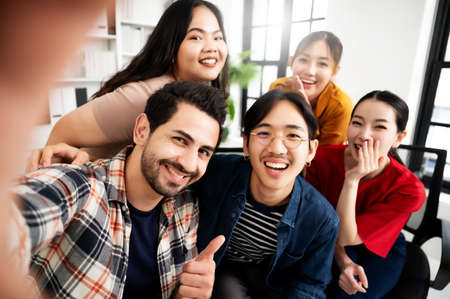 Selfie of group young man and woman team smiling having fun together