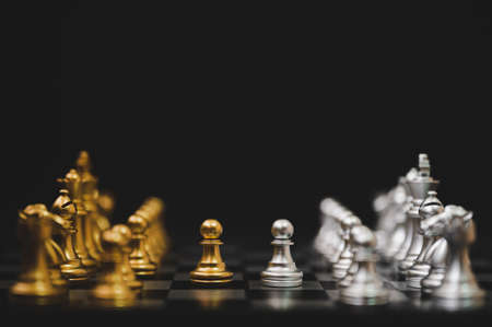 Business competition and strategy plan concept. Chess board game gold and silver colour 免版税图像