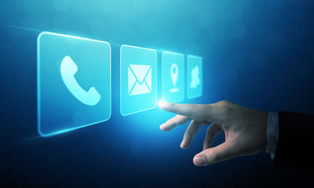 Businessman touching icon mobile phone, mail, telephone and address. Customer service call center contact us concept