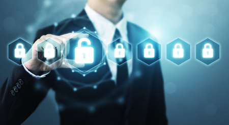 Protection network security computer and safe your data concept, Businessman holding shield protect icon Stockfoto