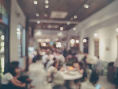 Blurred images of the coffee shop cafe interior background and lighting bokeh Archivio Fotografico