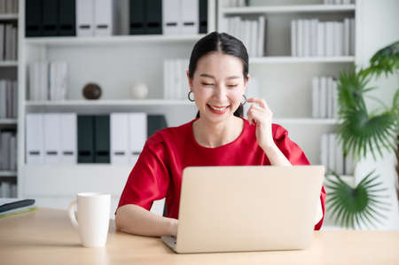 Work from home concept, Portrait of beautiful young asian woman working on laptop in workplace 免版税图像