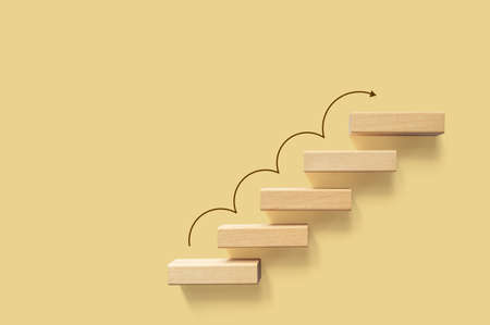 Growth or increase design concept. Cube block staircase moving step growing up to target. Success achievement or goal business motivation