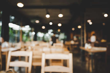 Blurred images of restaurant and coffee shop cafe interior background and lighting bokeh