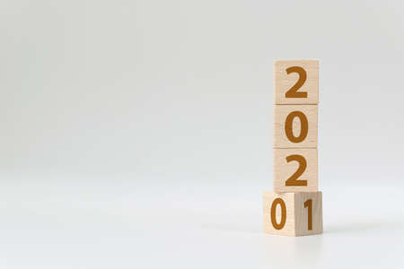 New year 2020 change to 2021 concept. Wooden cube block flip over change years