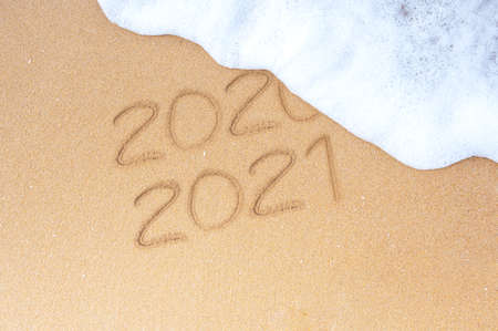 New year resolutions. Change year 2020 to 2021. Sandy beach with foam wave