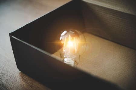 Light bulb in the black box. Concept of inspiration creative idea thinking and future technology innovation 版權商用圖片
