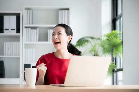 Excited female feeling euphoric celebrating online win success achievement result, young woman happy about good email news, motivated by great offer or new opportunity, passed exam, got a job