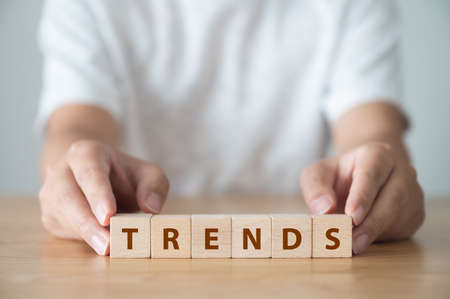 Trends concept. The word TRENDS on wooden cube block