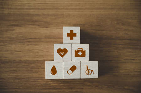 Wooden block stacking with icon healthcare medical, Insurance for your health concept