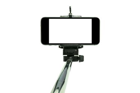 Smartphone on a selfie stick shot in studio Stock Photo