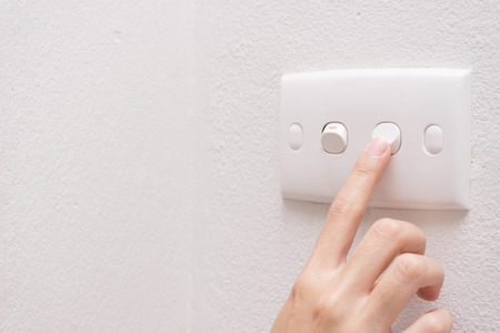 Press turn on/off electrical switch Stockfoto