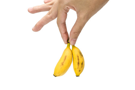 samll: Hand holds samll old banana Isolated on a white background