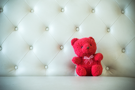 red sofa: Cute teddy color red with sofa Stock Photo