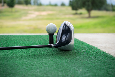driving range: Close-up of a golf ball and a golf wood on a driving range