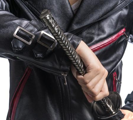 samurai sword: Man hand holding samurai sword on white background, Leather jacket Stock Photo