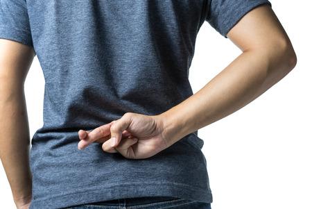 Man fingers crossed behind a backside