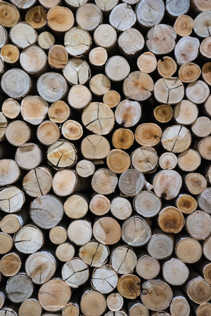 lumbering: closeup of a pile of cut timber background