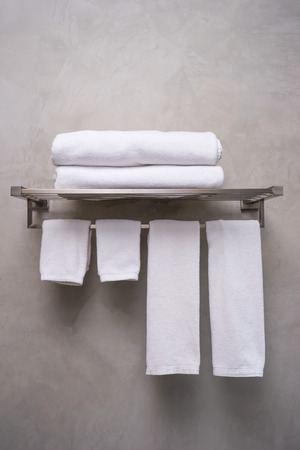 Clean white towel on a hanger for two people