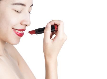 applying lipstick: Asian Woman , Applying lipstick ,isolated Stock Photo