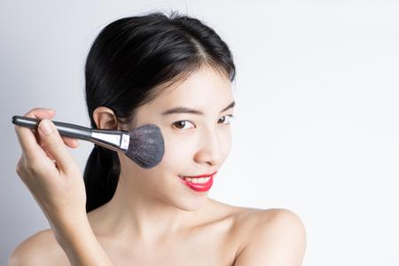 blusher: Woman Make-up With Blusher Stock Photo