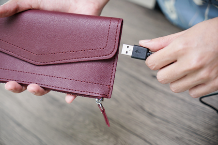 women hand charging money wallet