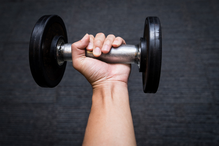 dumbbell on man hand, heavy weight
