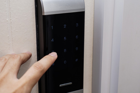 the hand touch on electronic key door