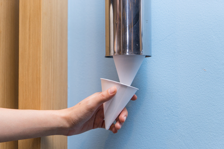 the hand pulling funnel paper cup