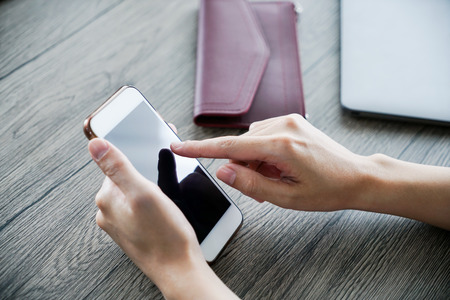 the women hand use mobile phone , shopping online
