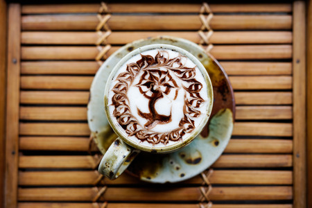 Hot drink coffee cappuccino latte art on wood table Stock Photo