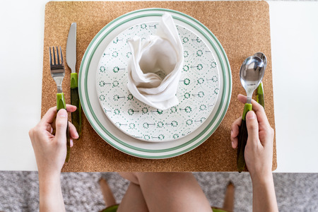 Female hands with empty plate For Meal Waiting