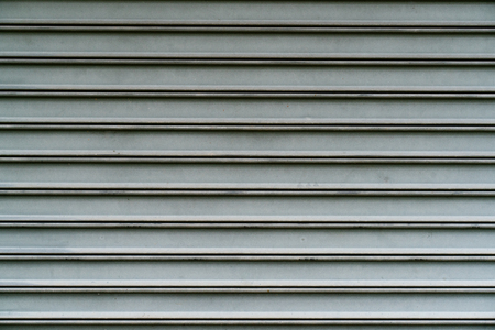 close up of metallic roll up door surface Imagens - 108996556