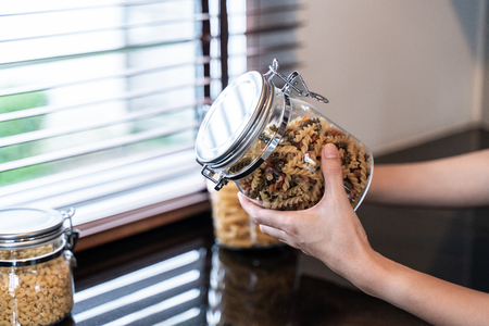 hand hold bottle of Fusilli in kitchen