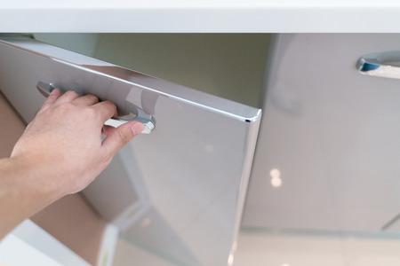 hand Open Kitchen Cabinet Stock Photo