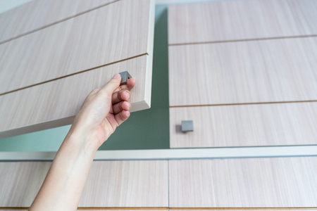 hand Open Cabinet Stock Photo
