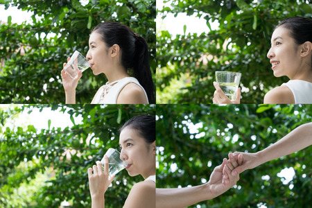 photo group of Portrait woman drinking water outdoor in green park