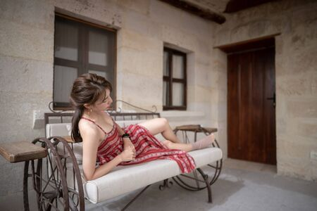 Woman relaxing in cave style hotel room in Cappadocia. GOREME, TURKEY